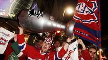Montreal Canadiens fans celebrate in the streets of downtown Montreal, April 28, 2010, following their team's victory over the Washington Capitals to eliminate the top-ranked team from first round playoff action. (CHRISTINNE MUSCHI/REUTERS)
