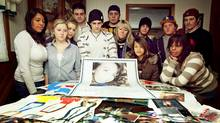 Friends and family of Reilly Anzovino stand behind photos and drawings of Reilly in her family's kitchen on Jan. 16, 2009. (JENNIFER ROBERTS/Jennifer Roberts for The Globe and Mail)
