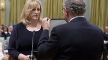 Lisa Raitt is sworn in as minister of transport during a ceremony at Rideau Hall in Ottawa on Monday, July 15, 2013. (Adrian Wyld/THE CANADIAN PRESS)
