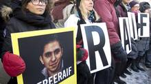 Ensaf Haidar, left, wife of blogger Raif Badawi, takes part in a rally for his freedom, Tuesday, January 13, 2015 in Montreal. John Baird's meetings with a Saudi prince appear set to take place even as Canada condemns Saudi Arabia for sentencing blogger Raif Badawi to 1,000 lashes and 10 years in prison for insulting Islam. Mr. Badawai's wife and children were granted asylum in Canada in 2013. (Ryan Remiorz/THE CANADIAN PRESS)