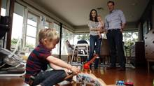 Evan and Jennifer Brown with their children Jackson, 4, and baby Emily at home in Victoria, B.C. (CHAD HIPOLITO FOR THE GLOBE AND MAIL)