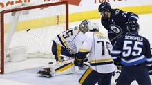 Winnipeg Jets' Blake Wheeler scores the game-winning goal against Nashville Predators goalie Pekka Rinne as Predators' P.K. Subban and Jets' Mark Scheifele look on during third period NHL action in Winnipeg on Saturday, April 8, 2017. (JOHN WOODS/THE CANADIAN PRESS)