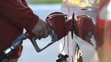 A motorist fuels up in Toronto. (Fred Lum/The Globe and Mail/Fred Lum/The Globe and Mail)