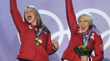 Kaillie Humphries and Heather Moyse celebrate their gold medal at the 2010 Vancouver Olympic Winter Games (Mathew McCarthy/The Canadian Press)