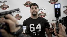 Offensive lineman Scott Mitchell speaks to reporters following the 2011 CFL evaluation camp in Toronto Sunday, March 6, 2011. (Darren Calabrese/The Globe and Mail)