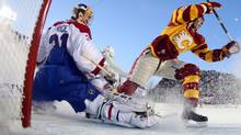 Montreal Canadiens goalie Carey Price, left, looks on as Calgary Flames David Moss celebrates a Flames goal during the second period of the NHL Heritage Classic in Calgary, Alta., Sunday, Feb. 20, 2011. The Calgary Flames beat the Montreal Canadiens 4-0. THE CANADIAN PRESS/POOL, Andre Ringuette (Andre Ringuette/THE CANADIAN PRESS)