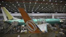 A Boeing 737-900 sits on the assembly line at the company's operations in Renton, Wash. Higher costs and tightening of funds could put pressure on manufacturers such as Boeing Co. and Airbus SAS to fill the gap with more customer finance, the PwC report said. (ANDY CLARK/REUTERS)