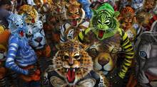 Artists with painted bodies and masks perform at the annual Pulikali, or Tiger Dance, in the southern Indian state of Kerala. (Arun Sankar K./AP)