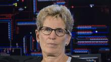 Ontario Premier Kathleen Wynne listens to a question from the media after touring the Hydro Ottawa control room on Sept. 16, 2016. (Adrian Wyld/THE CANADIAN PRESS)