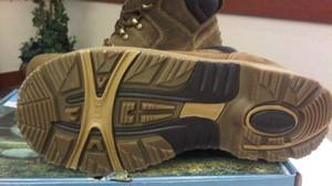 OPP officers present the style of boots that they say may help them find the killer of a