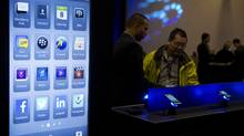 People browse the kiosks at a BlackBerry event in Toronto on Thursday, May 8, 2014. (Matthew Sherwood For The Globe and Mail)