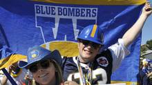Winnipeg Blue Bombers fans cheer for their team outside Mosaic Stadium prior to their CFL game against the Saskatchewan Roughriders in Regina, September 4, 2011. REUTERS/Fred Greenslade (FRED GREENSLADE)