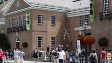 Fans walk outside the Baseball Hall of Fame and Museum on Friday, July 25, 2014, in Cooperstown, N.Y. (AP)