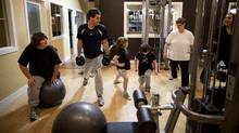 The Aarts family (from left) Keira,12, Jamie, 41, Kourtney, 7, Kassidy, 8, and Amber, 42, work out with trainer Tanya Stobbe. (Rafal Gerszak for The Globe and Mail/Rafal Gerszak for The Globe and Mail)