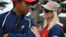 Tiger Woods and his wife Elin Nordegren talk on the golf course at the Presidents Cup golf compeititon in this October 11, 2009 file photo at Harding Park Golf course in San Francisco, Calif. (ROBYN BECK/Getty Images/ Robyn Beck)