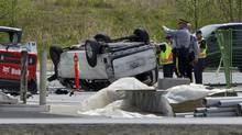 Police investigate the aftermath of a fatal car crash at the intersection of 176th Street and 32nd Avenue in Surrey, B.C., on April 28, 2013. (Eric Dreger/The Canadian Press)