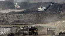 An Alberta oil sands operation. Oil and gas exports and investment in machinery and infrastructure in the oil sands accounted for fully one-third of Canada's economic growth in 2010 and 2011. (JEFF MCINTOSH/AP)
