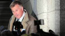 Minister of State for Small Business and Tourism, Maxime Bernier, speaks to media as makes his way through the foyer of the House of Commons on Parliament Hill in Ottawa on January 30, 2012.