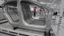 File photo of an assembly area at the Tesla factory in Fremont, Calif. (Paul Sakuma/AP)