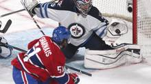 Winnipeg Jets goalie Al Montoya (35) makes a save against Montreal Canadiens center David Desharnais (51) during the second period at Bell Centre. (Jean-Yves Ahern/USA Today Sports)