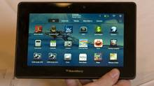 A prototype Blackberry PlayBook is displayed by an official of Research In Motion at the 2011 International Consumer Electronics Show in Las Vegas. (Steve Marcus/Reuters)