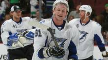 Steven Stamkos #91 of the Tampa Bay Lighting smiles after scoring the overtime winning goal during their game against the Vancouver Canucks at Rogers Arena on December 11, 2010 in Vancouver, British Columbia, Canada. Tampa Bay won 5-4 in overtime. (Photo by Jeff Vinnick/NHLI via Getty Images) (Rich Lam/2010 Getty Images)