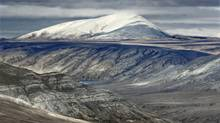 View of unnamed mount on Ellesmere Island, Nunavut, Canada, near Strathcona Fiord shortly after a July snowstorm. (Martin Lipman)