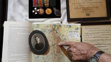 The map shows where William Barnett Evans, pictured to the left, fought at Vimy Ridge during the First World War. Above are the medals he won. (Christinne Muschi For The Globe and Mail)