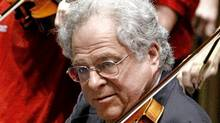 Violin virtuoso Itzhak Perlman performs the during the 100th anniversary celebration of Arizona's statehood, Tuesday, Feb. 14, 2012, at the Capitol in Phoneix. (Matt York/Matt York/The Associated Press)