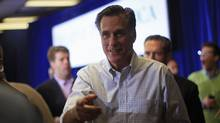 Republican presidential candidate and former Massachusetts Governor Mitt Romney greets supporters during a campaign stop at the American Legion in Moline, Illinois March 18, 2012. (JIM YOUNG/REUTERS/JIM YOUNG/REUTERS)
