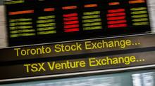 A sign board displaying Toronto Stock Exchange (TSX) stock information is seen in Toronto June 23, 2014. Foreign investors bought $10.23-billion worth of Canadian securities in December, sealing a new annual record for purchases of bonds, stocks and money market paper.. (Mark Blinch/Reuters)