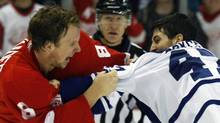 Toronto Maple Leafs left wing Darryl Boyce (R) and Detroit Red Wings left wing Justin Abdelkader fight each other during the second period of their NHL hockey game in Detroit, Michigan March 26, 2011. REUTERS/Rebecca Cook (REBECCA COOK)