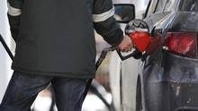 A man pumps gas at a Petro-Canada station in Toronto in 2011. (MARK BLINCH/REUTERS)