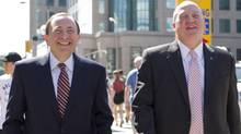 Gary Bettman (left) Commissioner of the NHL and Bill Daly, Deputy Commissioner and chief legal officer of the NHL leave the NHLPA offices in Toronto on Wednesday, August 22, 2012. (The Canadian Press)