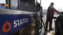 A man refuels his car at a Statoil station in Warsaw. The Norwegian company has signed a 10-year supply deal with Germany's Wintershall AG. (© Kacper Pempel/REUTERS)