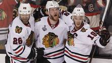 Chicago Blackhawks' Bryan Bickell (C) celebrates his goal against the Boston Bruins with teammates Michal Handzus (L) and Jonathan Toews during the third period in Game 6 of their NHL Stanley Cup Finals hockey series in Boston, Massachusetts, June 24, 2013. (Reuters)