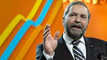 NDP Leader Thomas Mulcair addresses delegates following a confidence vote during the party's weekend convention on April 13, 2013 in Montreal. Mr. Mulcair urged his party to begin preparations for the next federal election. (Paul Chiasson/The Canadian Press)