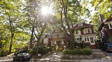 Large trees and beautiful homes line Normandy Boulevard in Toronto's Upper Beaches neighbourhood. (JENNIFER ROBERTS/Jennifer Roberts for The Globe and Mail)