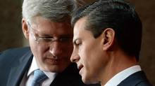 Prime Minister Stephen Harper takes part in a joint press conference with Mexican President Enrique Pena Nieto at the National Palace in Mexico City on Feb. 18, 2014. (SEAN KILPATRICK/THE CANADIAN PRESS)