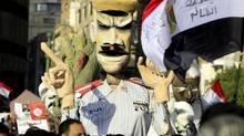 Egyptians opposing President Mohamed Morsi hold an effigy mocking him in Tahrir square in Cairo February 8, 2013. (MOHAMED ABD EL GHANY/REUTERS)