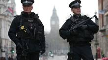 Armed police officers secure the area near the Houses of Parliament in central London on March 23, 2017 the day after the March 22 terror attack in Westminster claimed at least three lives including that of police officer Keith Palmer. (AFP/Getty Images)
