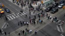 Scramble pedestrian crossing at the intersection of Dundas and Yonge Street in downtown Toronto on Sept. 7, 2011. (Moe Doiron/The Globe and Mail/Moe Doiron/The Globe and Mail)