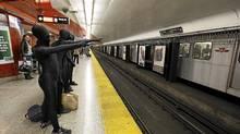 A group of zentai suit wearing teens have fun with transit users in Toronto. (Deborah Baic/Deborah Baic/The Globe and Mail)