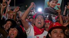 National League for Democracy supporters celebrate outside the NLD headquarters as they watch results come in for the byelections in Yangon, Myanmar (Adam Dean/Adam Dean)
