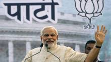 Hindu nationalist Narendra Modi, the prime ministerial candidate for India's main opposition Bharatiya Janata Party (BJP), gestures as he addresses his supporters during a public meeting in Vadodra, in the western Indian state of Gujarat, May 16, 2014. Hindu nationalist Narendra Modi said on Friday that he would work for the good of all Indians after his opposition party's resounding general election victory. REUTERS/Amit Dave (INDIA - Tags: ELECTIONS POLITICS) (AMIT DAVE/REUTERS)