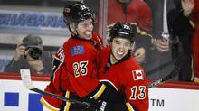 Calgary Flames' Sean Monahan, left, celebrates his goal with teammate Johnny Gaudreau during third period NHL hockey action against the Carolina Hurricanes in Calgary, Wednesday, Feb. 3, 2016. (Jeff McIntosh/THE CANADIAN PRESS)