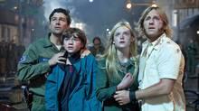 From left, Kyle Chandler, Joel Courtney, Elle Fanning and Ron Eldard in Super 8. (Francois Duhamel/Francois Duhamel / AP)