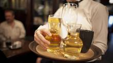 Alberta's minimum wage went up Saturday by one dollar to $12.20 an hour, and by $1.50 for liquor servers, with the elimination of the liquor-server wage. (Chris Bolin For The Globe and Mail)