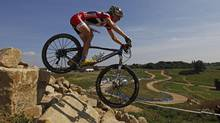 Canada's Catharine Pendrel competes in the Women's Cross Country Mountain Biking test event at Hadleigh Farm, east of London July 31, 2011. Mountain biking is one of the London Organising Committee of the Olympic Games (LOCOG) test events for the 2012 Olympic games. (Eddie Keogh/Reuters/Eddie Keogh/Reuters)