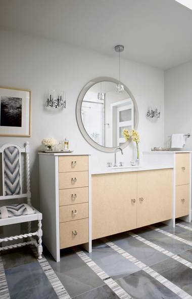 GO FOR A LIGHT WOOD TONE: Here, light-hued bird's-eye maple veneer adds a welcome cheeriness to the fronts of a custom vanity. If you're adding an unexpected accent, always be sure to reinforce with repetition — anything good is worth doing again in my books! (Stacey Brandford for The Globe and Mail)